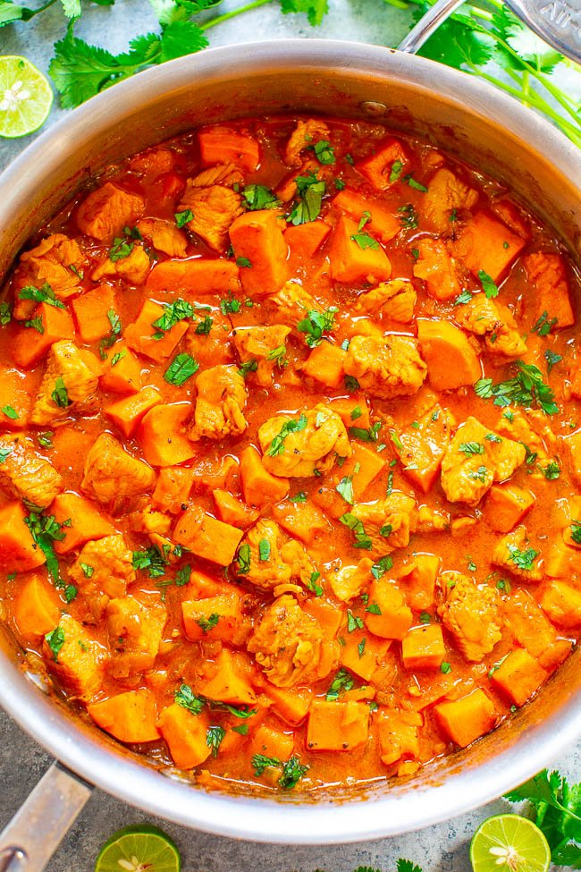 Coconut Lime Chicken and Sweet Potato Curry -An EASY, one-skillet curry that's ready in 20 minutes and tastes BETTER than a restaurant!! Juicy chicken and tender sweet potatoes simmer in a lime-scented coconut milk sauce that tastes AMAZING! Healthy comfort food!!