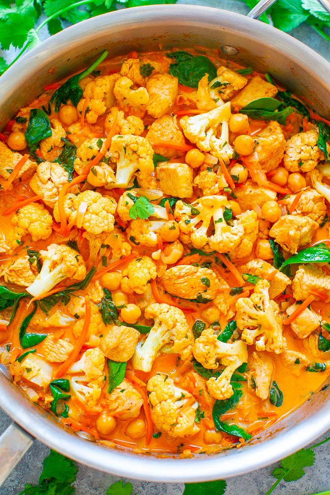 Cauliflower, Chickpea, and Chicken Coconut Curry - An EASY, one-skillet curry that's ready in 20 minutes and tastes BETTER than a restaurant!! The Thai-inspired coconut milk broth makes this healthy comfort food taste AMAZING!!