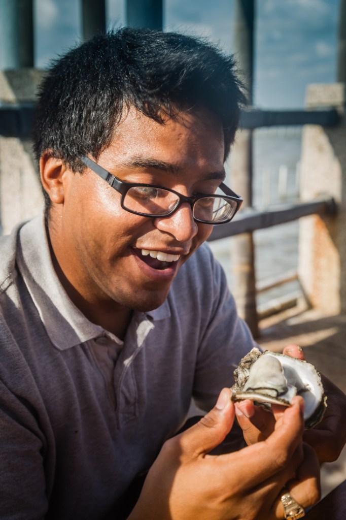 Qigu Lagoon Juan Eating Oyster