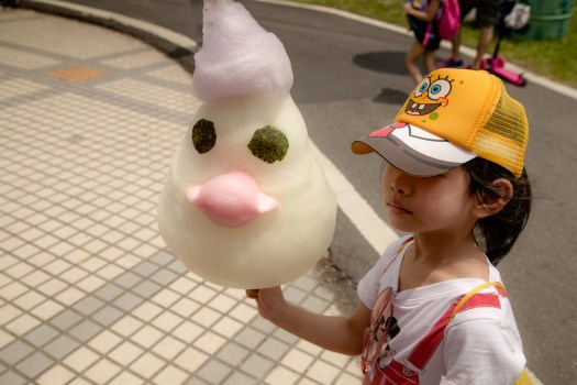 dragonboat festival small girl with cotton candy