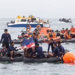 Indonesian Navy divers locate wreckage of Sriwijaya Air flight SJ182 in the waters off Jakarta coast.