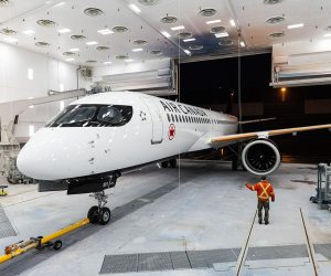 Air Canada A220 in paint shop