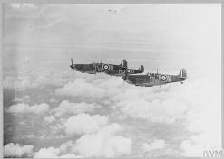 TYPES OF ROYAL AIR FORCE AIRCRAFT : SUPERMARINE SPITFIRE (CH 739) Original wartime caption: [See CH.733] Picture shows ? Flight of Submarine Spitfires on patrol duty. Copyright: © IWM. Original Source: http://www.iwm.org.uk/collections/item/object/205442410
