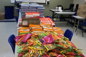 Donated school supplies waiting to be stuffed into backpacks by AIM Houston.
