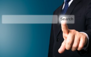 Business person working with modern virtual technology (screen search button)