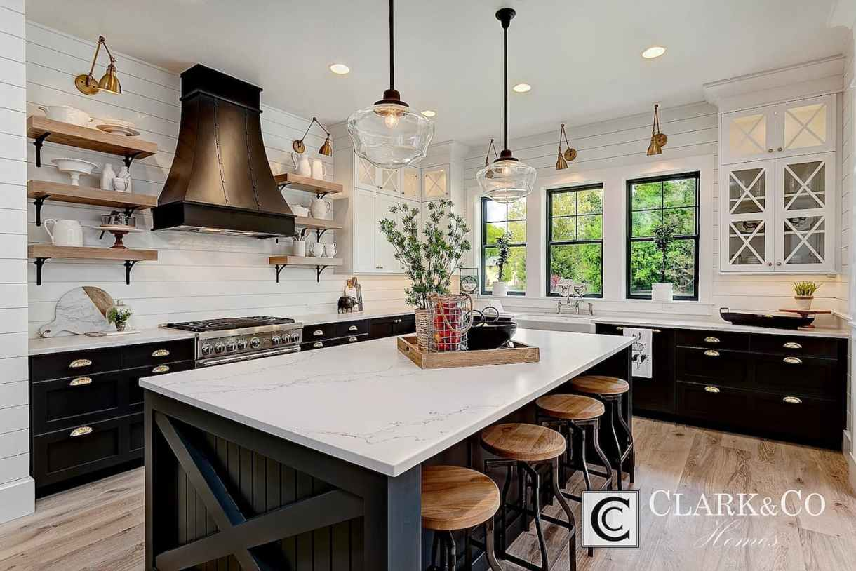 Black and white modern farmhouse glam kitchen with shiplap walls, large marble island bench and open shelving