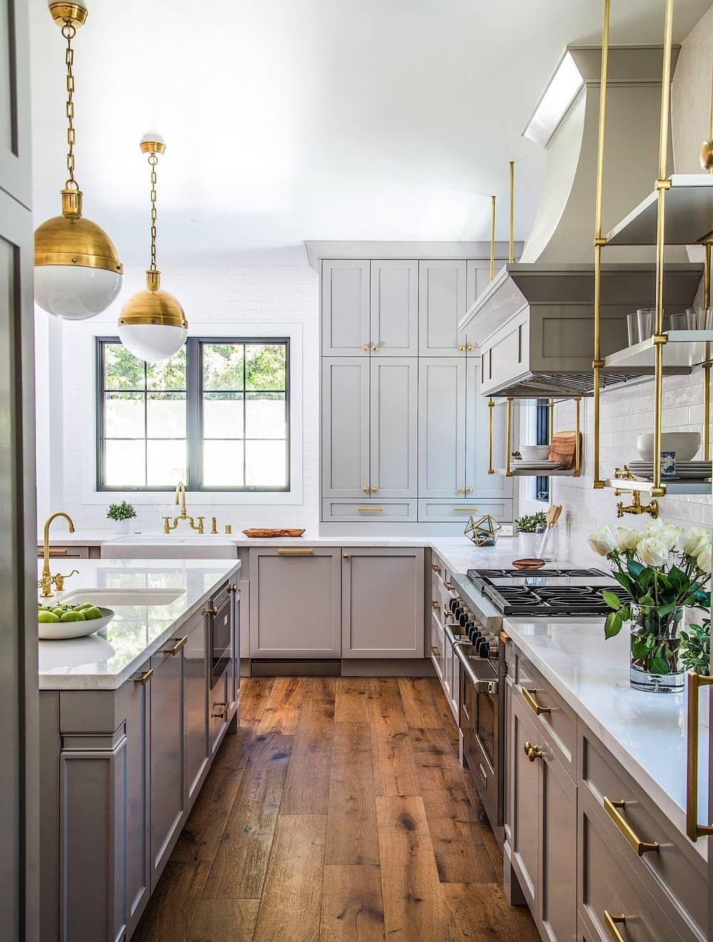 17 Fixer Upper Style Modern Farmhouse Kitchens   Glam grey kitchen with gold fixtures, gorgeous pendants and open shelving   A Visual Merriment