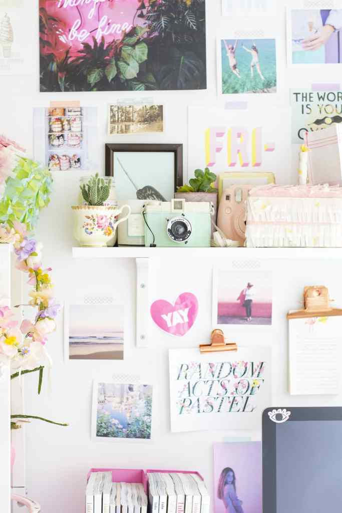 wall with shelf and lots of pictures