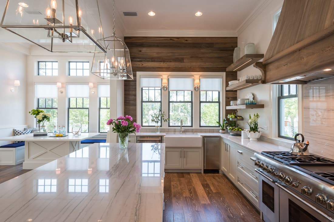 Modern fixer upper style modern farmhouse kitchen with timber feature wall, open shelving and large island bench