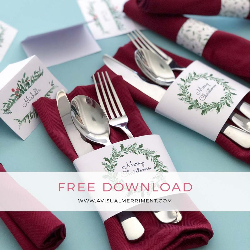 cutlery and napkins wrapped in christmas bands with place cards
