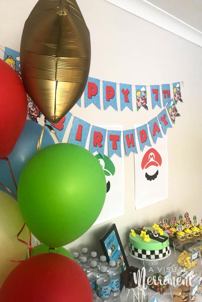 balloons at boy's nintendo themed birthday with bunting and food table