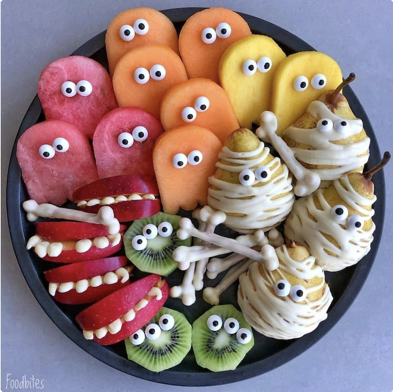 chopped fruit halloween decorated with eyes