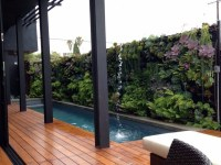 Vertical garden next to the swimming pool brings more ...