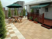 Lay patio and balcony with wooden tiles  Use wood tiles ...