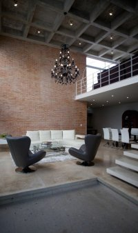 Minimalist house with an industrial touch in Canun, Mexico ...
