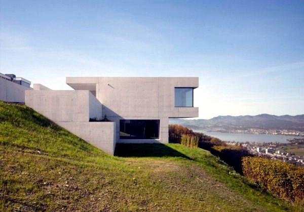 Modern House with Minimalist Design on a slope  Villa K