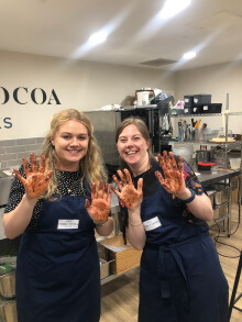 Nicole and Lynne with chocolate hands