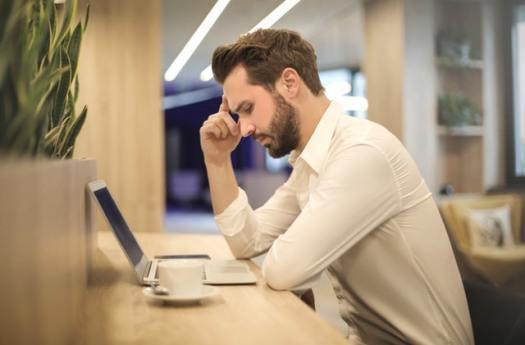 Man using the laptop thinking