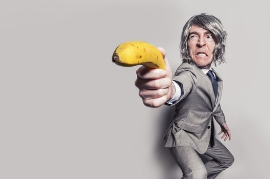 A sales rep pointing a banana representing why everyone hates sales reps.