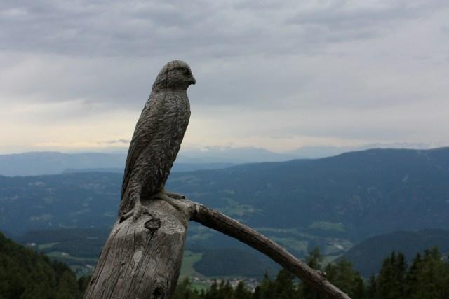 Bird sculpture watching the path