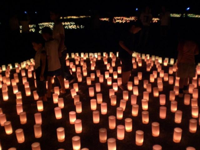 People walking through the lanterns