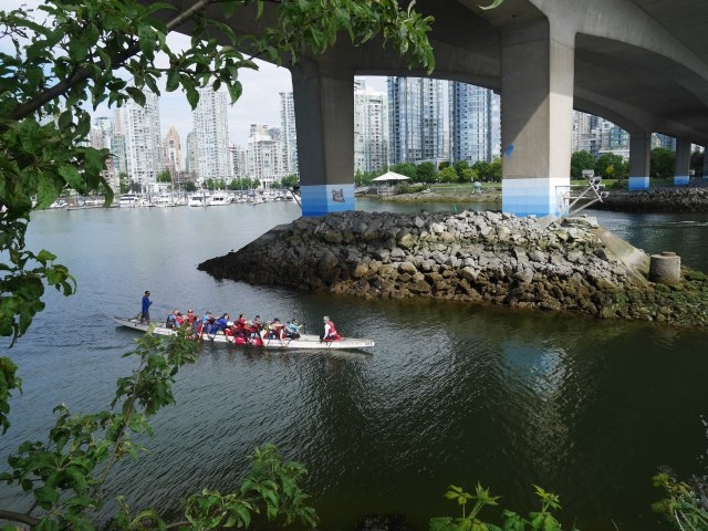 Cambie Street Bridge with people practising dragon boat races