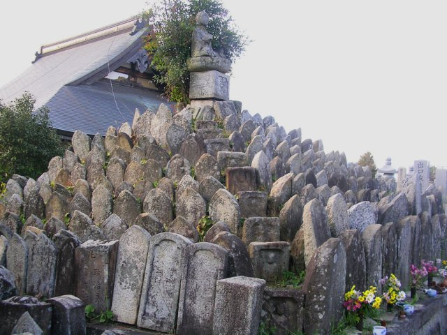 Stones piled up by an old temple
