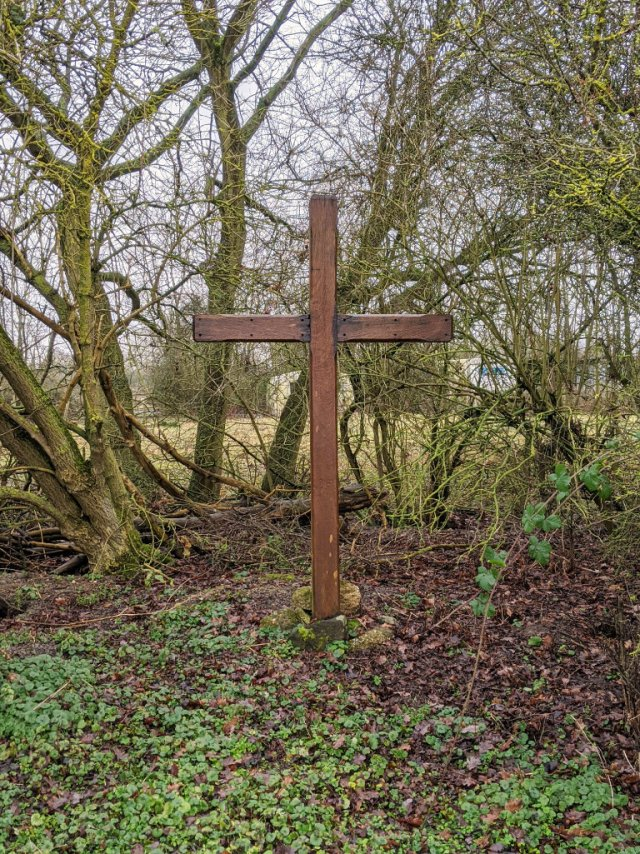 The cross behind the Peace Garden