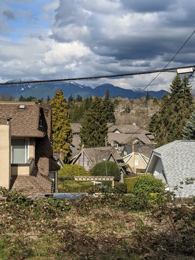 35th Arbutus Greenway - looking over houses and mountains