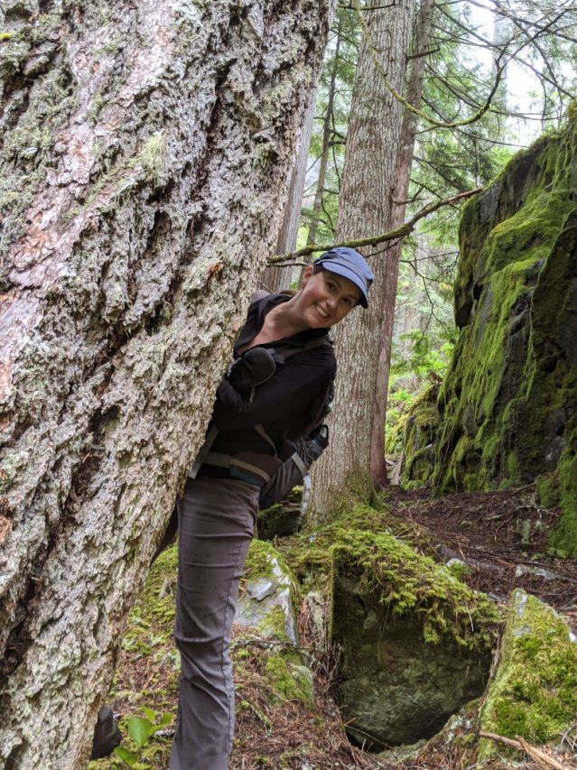 Me for scale with an old growth tree