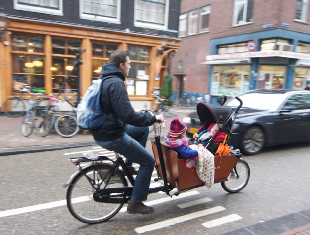 Bike riding parent with children