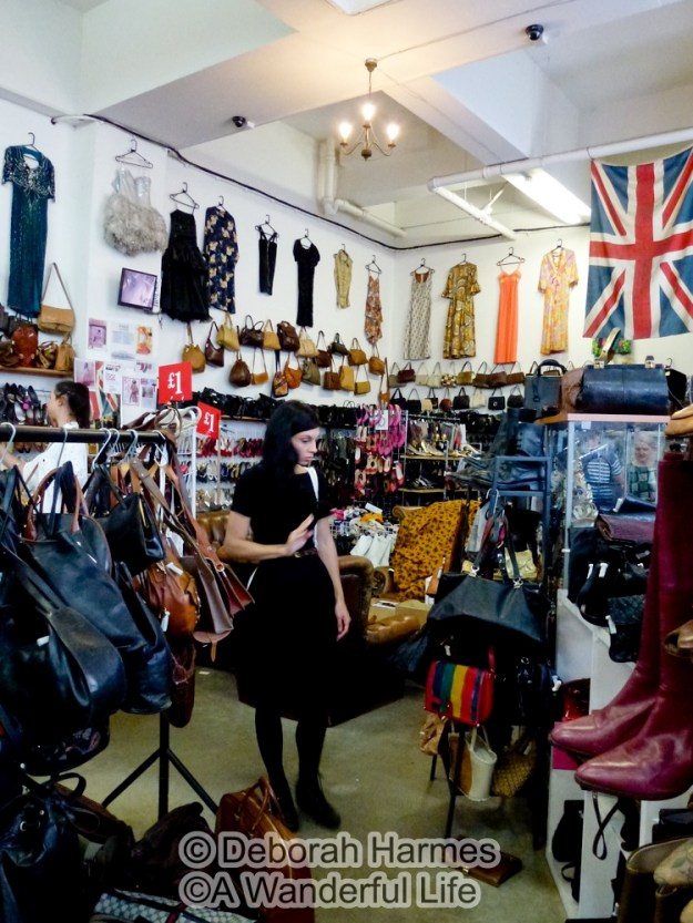Shopping in Absolute Vintage on Hanbury Street off Brick Lane in London.
