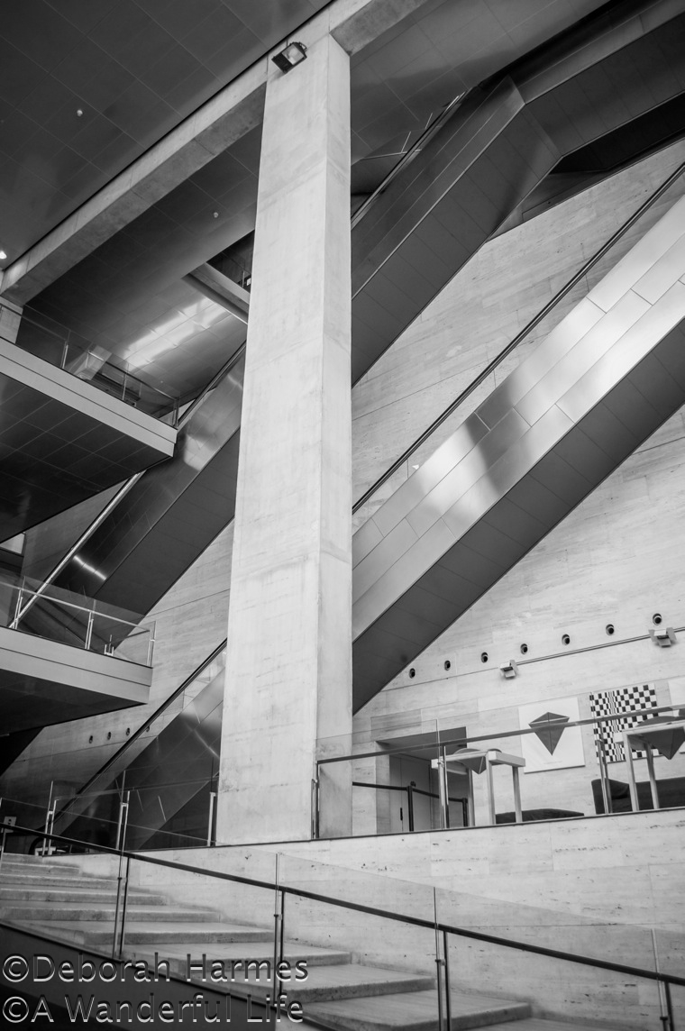 the crisp geometric angles of the interior lobby in the cccb museum of art and culture in barcelona spain