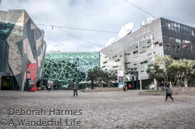 The buildings of Federation Square in Melbourne, Australia contain a cluster of arts organisations, a television and radio broadcasting centre, and several cafes and restaurants.