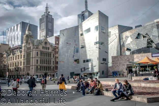 The fractured and fragmented facades of the modern buildings at Federation Square in Melbourne, Australia are a sharp contrast to the more traditional structures all around it.