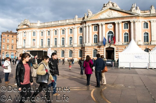 The plaza in front of the Capitole building in Toulouse is frequently crowded with both tourists and local residents.