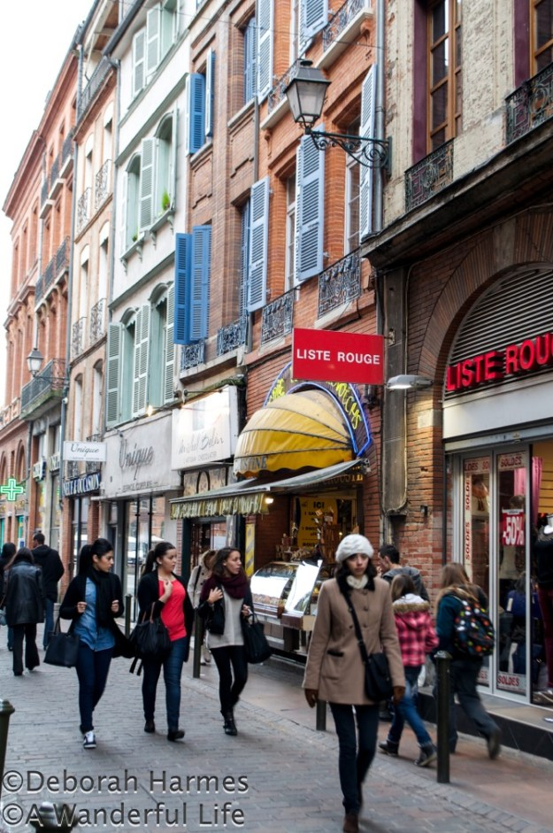 Shoppers on Rue du Saur in Toulouse, France.