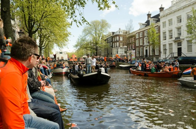 Canalside in Amsterdam for the King's Day festival