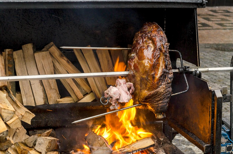 Ham over a fire at the Wenceslas Square Christmas market