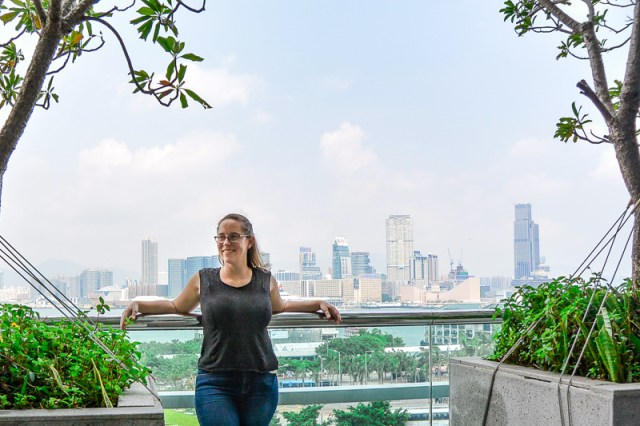 Jess at the IFC Mall with a view of Kowloon