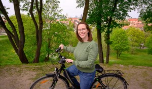 Jess on bike with overlook in Vilnius