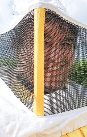 Sean in a beekeeping suit