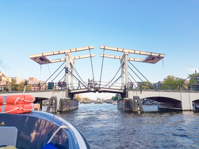 canal cruise in amsterdam with bridge