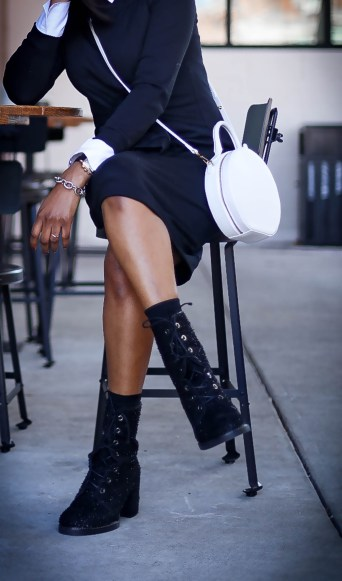 Black sweater dress worn with black combat boots by stuart weitzman. Atlanta blogger wearing white bag and fall winter fashion trends-10