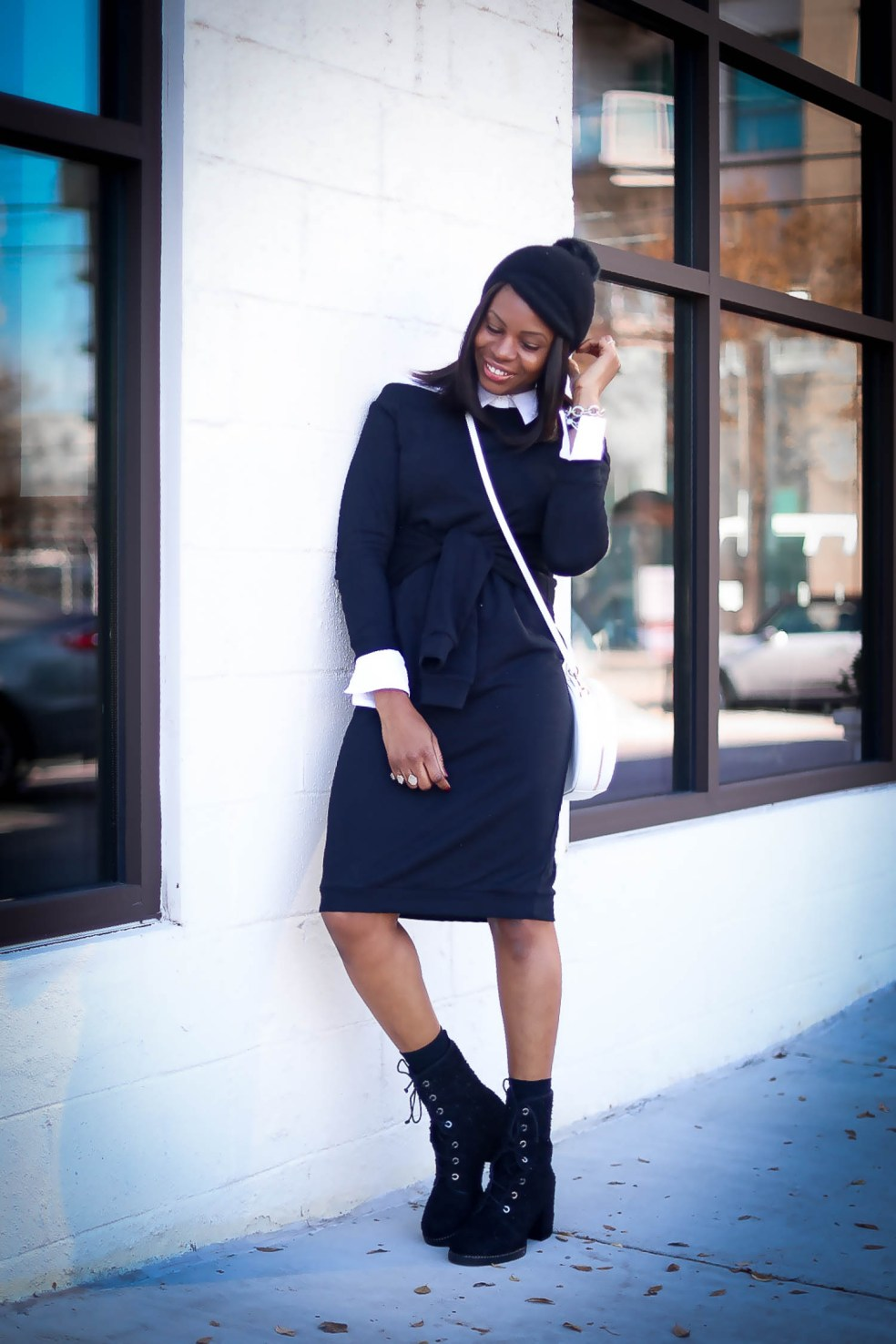 Black sweater dress worn with black combat boots by stuart weitzman. Atlanta blogger wearing white bag and fall winter fashion trends-3