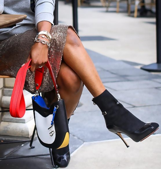 Atlanta fashion blogger wearing a j.crew plaid sweatshirt, sequin skirt, white gucci sunglasses and black high-heel booties-2