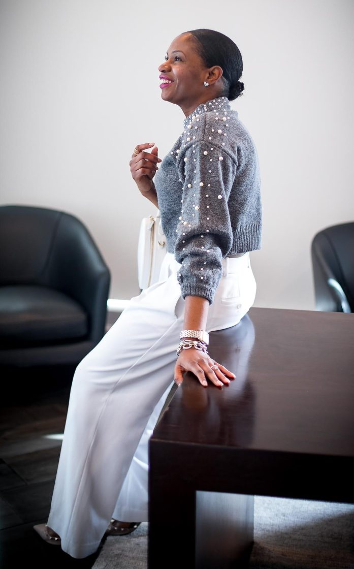 Atlanta fashion blogger wearing grey crop sweater with pearl details and white wide-leg pants. white circle bag and valentino rockstuds. Cold weather glam-4