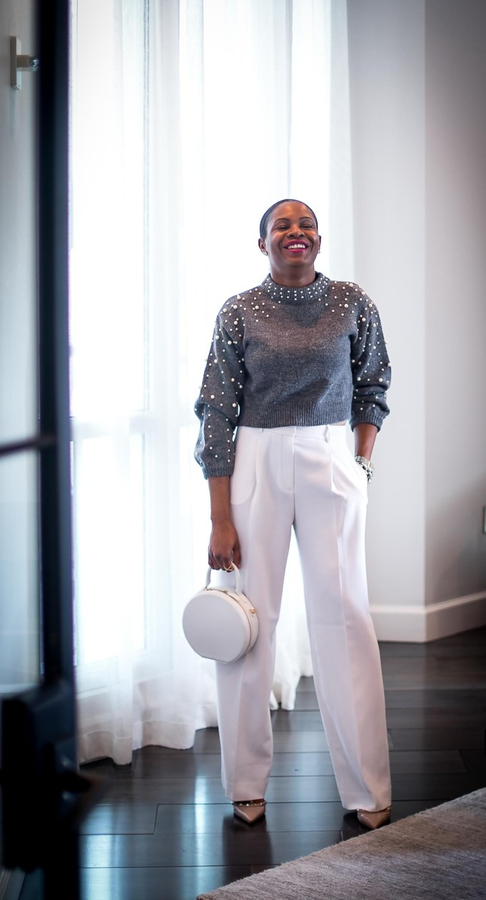 Atlanta fashion blogger wearing grey crop sweater with pearl details and white wide-leg pants. white circle bag and valentino rockstuds. Cold weather glam-8