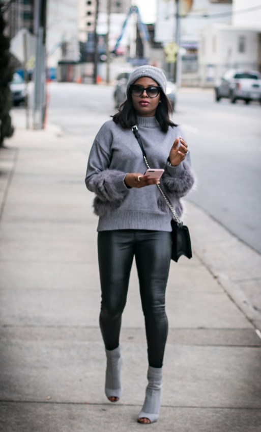 Atlanta fashion blogger wearing leather leggings, grey sweater with fur details and grey sock booties.-1