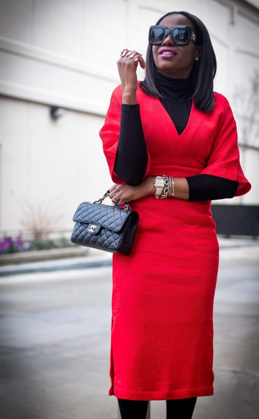 Atlanta style blogger wearing a red work dress with spanx hosiery, black booties, black gucci sunglasses, a turtleneck top and chanel top. -1